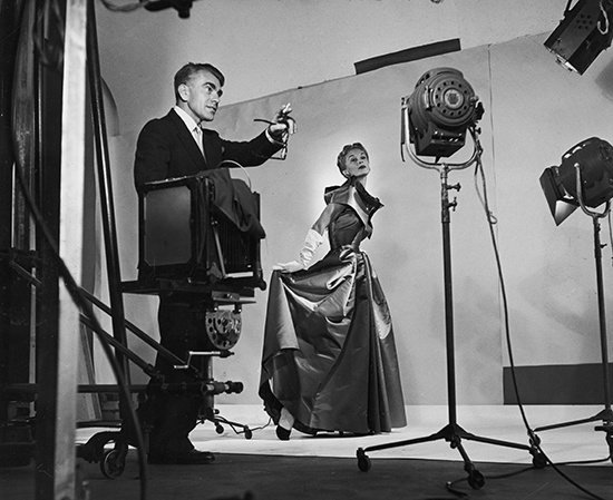 NEW YORK, UNITED STATES - SEPTEMBER 1949: Photographer Horst directing lights and cameras before taking fashion pix of Lisa Fonssagrives. (Photo by Roy Stevens/Time & Life Pictures/Getty Images)